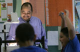 4th grader Manuel Rodriguez, right, cheers as the students beat the teacher, Juan Osorio in a...