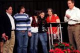 (PG2352) Pastor Brady Boyd (right) leads a prayer for the Works family during a service around the...
