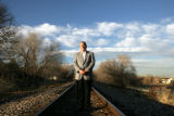Mayor Chuck Sisk (cq) of Louisville, Colorado stands on railroad tracks that will be used for the...