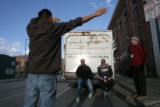 David Murphey (cq) blocks the sun with his hands for mission workers Kevin Jones (cq) and Kirk...