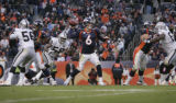 JPM1227 Denver Broncos Jay Cutler (6) passes against the Oakland Raiders  in the third quarter on...