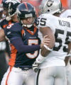 0601 Denver Broncos PK Matt Prater #5 runs into Oakland Raiders linebacker Jon Alston #55 as he...