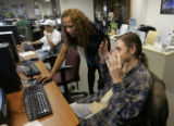Josh Damankos ,puts his hands up in frustration as he tries to registersso he can search use...