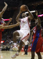 HTR110 - Houston Rockets' Ron Artest (96) goes up for a shot as Los Angeles Clippers' Zach...