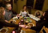 3-time Olympic ski racer Sarah Schleper leads her family in grace before an early...