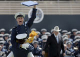 Air Force Academy cadets from the Class of 2005 celebrate as United States Vice President, Dick...