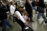 DM0337  Natasha Ragland of Niwot hugs her grandmother Paula Hallam who flew in for Thanksgiving...