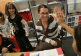3rd grade teacher Emily Weber gets a high five from student Jay Kum, right, during a gifted and...