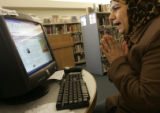 Soud Al Taai claps her hands after successfully logging onto her Yahoo e-mail account on a...