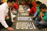MJM122  Dominic Martinez (cq), left, who runs the chess club  at Ricardo Flores Magon Academy in...