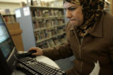 Soud Al Taai reads an e-mail from her sister on a computer in the Denver Public Library's Virginia...