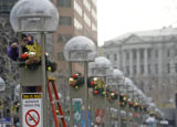 Refugio D'Lao (cq) works on the 16 street mall's christmas decorations on November 25, 2008.  ...
