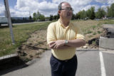 Granby Mayor, Ted Wang (cq) stands in front of a vacant lot May, 31, 2005 that was once the town...