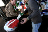 (PG2589) Staff members Richard Yochim (left) and Kyle Petrie count and organize turkeys at the...