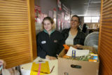 Heather Reeves (cq) (left) and her mother Rose Ellen Tyrrell, pick up their food, Wednesday...