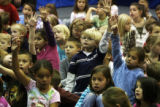 Children holp up their hands  with questions for Yohannes Gebregeorgis (cq) at Arrowwood...