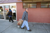 Roy Salas (cq) heads for home, after he picked up some , Wednesday morning, November 12, 2008,...