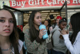 Evelyn Benitez, 14, (cq) drinks a Slurpee as she walks out of a convenience store on Thursday,...