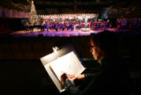 (0043) Mary Louise Burke, Associate Director of the Colorado Symphony Chorus, takes notes as the...