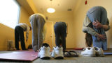 Residents take part in a stretch class at a SPAN shelter, Wednesday afternoon, in Boulder.  SPAN,...