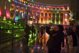 (439) People indulge their holiday spirit as they enjoy the Christmas lights of the Larimer...