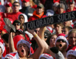 (0408) Huskers fans hold a Colorado Sucks sign before the start of Colorado against Nebraska at...
