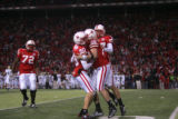 (1466) Nebraska celebrates after Alex Henery hit a 57 yeard field goal for the lead in the fourth...