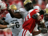 (1557) Maurice Lucas tackles Roy Helu Jr., in the third quarter of Colorado against Nebraska at...