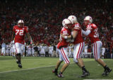 (1463) Nebraska celebrates after Alex henery hit a 57-yard field goal in the fourth quarter of...