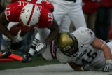 Quentin Castille (cq) of Nebraska is knocked out of bounds by Jeff Smart of Colorado during the...