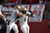 #41 Jake Behrens (cq) and #8 Demetrius Sumler (cq) of Colorado celebrate after a score during the...