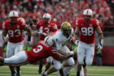 #3 Jimmy Smith of Nebraska reaches to tackle #9 Tyler Hansen (cq) during the 1st half of the...