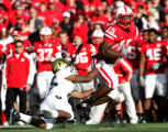 #25 Kevin Moyd (cq) of Colorado reaches to tackle #15 Beau Davis (cq) of Nebraska during the 1st...