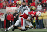 #40 Brad Jones (cq) of Colorado tackles #17 Todd Peterson (cq) of Nebraska during the 1st half of...