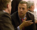 Mayor John Hickenlooper, left, and Baltimore, Maryland Mayor Martin O'Malley talk after...