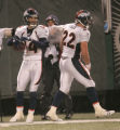 1551 Denver Broncos wide receiver Brandon Stokley (14) celebrates with teammate Denver Broncos FB...