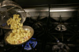 Chef Matt Mine adds pasta shells to sauted shrimp for his Tiger Shrimp and Shells dish to go with...