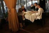 Chef Matt Mine, in white, sits with Oceanaire Seafood Room Host Shay Jenkins, left, while they and...