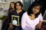 (Lt. to Rt.) James Nunley's sister Lynnell Ford, 28, (cq), left, his mother Andrea Alexander (cq),...