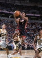 7 Dec 2001:  Point guard Rod Strickland #1 of the Miami Heat shoots over point guard Earl Watson...