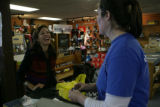 Cecilia Reed (cq) of Houston, Texas returns clothes to Suzanne Phillipson (cq) at Larson's Ski and...