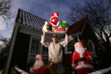 (0023) Portrait of Mike Thurman in front of his home wher somebody stole a plastic Santa and...