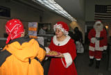Mrs Claus ( Marcela Rivera - cq) gives out cookies,Tuesday morning, December 2, 2008, Denver Main...