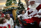 MJM144  Alyssa Moulin, 3, watches as Signing Santa asks her with sign language what she would want...