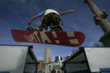 Snowboarder Pauly Weston  (cq) from Winter Park  rides a tabletop built at Civic center Park ...