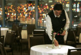 John Vargas lights table candles  in the Augusta room at The Westin Taber Center Tuesday night...