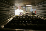 Executive Chef Jean- Luc Voegele loads  desert trays in the kitchen for  the Augusta room at The...