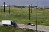 Cars and trucks zoom past the StorageTek campus off US 36 right near the Louisville exit Thursday...