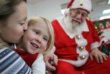MJM075  Elie Musfeldt, 3, is kissed by her mother, Kerry Musfeldt (cq) as they visit Santa Claus...