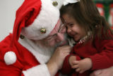 MJM165  Abby Curtis, 3, is hugged by Richard Gibboney (cq) as took on the persona of Santa Claus...